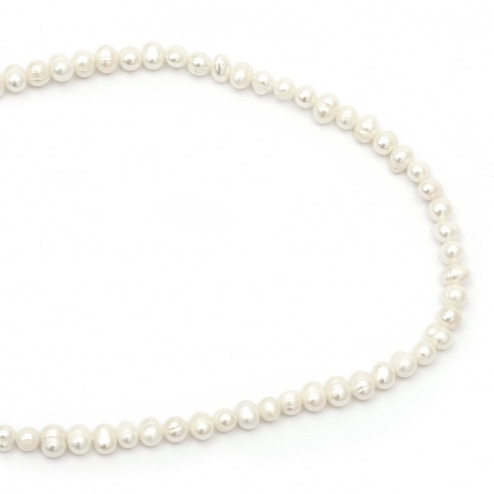 Наниз мъниста естествена перла 6±7 мм дупка 0.8 мм цвят крем ±60 броя