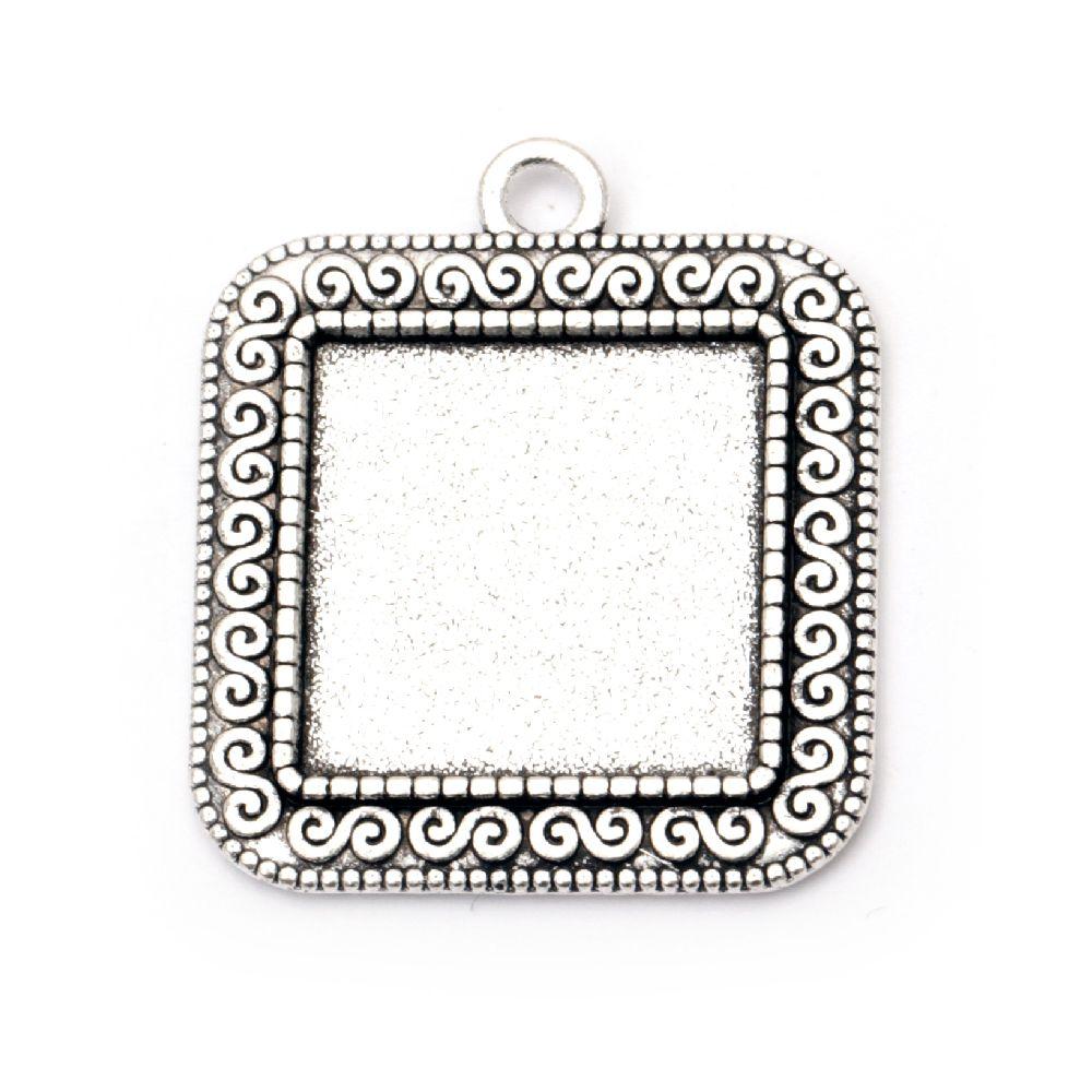 Καστόνι μεταλλικό τετράγωνο κρεμαστό 34x30x2 mm εσωτερικό 20x20 mm τρύπα 3 mm παλιό ασήμι