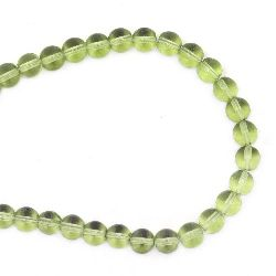 Наниз мъниста стъкло топче 6 мм дупка 0.5 мм прозрачно зелено светло ~52 броя