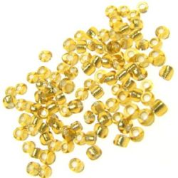 Мъниста стъклена 2 мм сребърна нишка златна 2 -50 грама