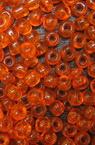 Γυάλινες χάντρες seed 3 mm διαφανές σκούρο πορτοκαλί -50 γραμμάρια