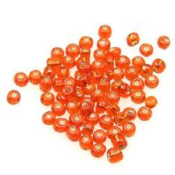 Мъниста стъклена 4 мм сребърна нишка оранжева -50 грама