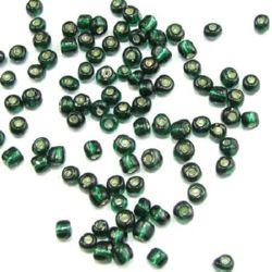 Мъниста стъклена 4 мм сребърна нишка тъмно зелена -50 грама