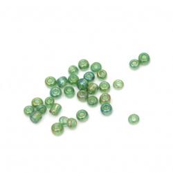 Мъниста стъклена 3 мм прозрачна дъга зелена 2 -50 грама