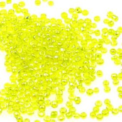 Γυάλινες χάντρες seed 2 mm διαφανές rainbow κίτρινο -50 γραμμάρια