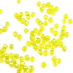 Мъниста стъклена 4 мм прозрачна перлена жълта -50 грама