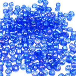Мъниста стъклена 2 мм прозрачна дъга тъмно синя -50 грама
