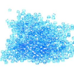 Мъниста стъкленa 2 мм прозрачна дъга синя 3 -50 грама