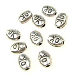 Talon metalic oval 7x5 mm gaură 1 mm culoare argintiu -20 bucăți