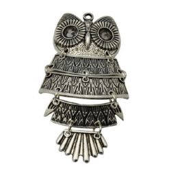 Metal owl shape, jewelry dangle element with embossed ornaments 20x48x4 mm hole 2 mm silver