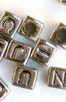 Bead metallized  letters 6.5x6.5 mm hole 3.5 mm -50 grams ~ 280 pieces