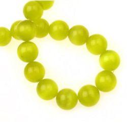 Наниз мъниста стъкло котешко око топче 12 мм дупка 1.5 мм жълто тъмно ~33 броя