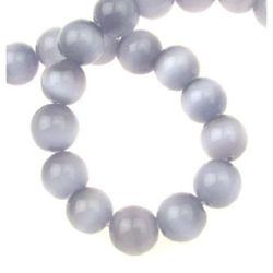 Наниз мъниста стъкло котешко око топче 12 мм дупка 1.5 мм лилаво ~33 броя