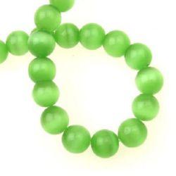 Șirag de mărgele din sticlă ochi de pisică mărgea 10 mm gaură 1,5 mm verde deschis ~ 40 bucăți