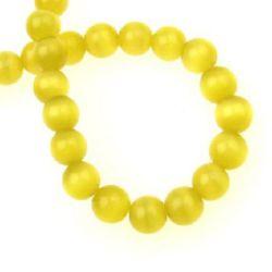 Наниз мъниста стъкло котешко око топче 8 мм дупка 1 мм жълто тъмно ~50 броя