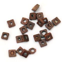 Шайба дърво 4x2 мм дупка 2.5 мм кафява -20 грама ~800 броя