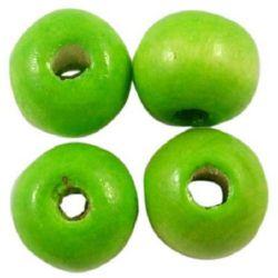 Топче дърво 4x5 мм дупка 1.5 мм зелено светло -50 грама ~ 1000 броя