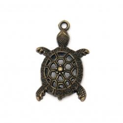 Висулка метална костенурка 39x25x7 мм дупка 2.5 мм цвят антик бронз -2 броя