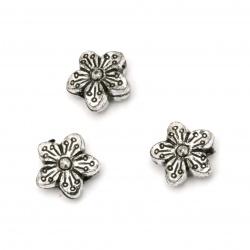Мънисто метализе цвете 15x7 мм дупка 2.5 мм цвят сребро -50 грама ~70 броя