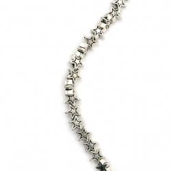 Наниз мъниста метал звезда 6x6x3 мм дупка 1.5 мм цвят сребро ~43 броя