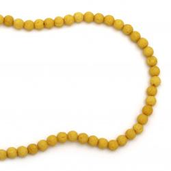 Наниз мъниста полускъпоценен камък ВУЛКАНИЧЕН - ЛАВА жълт топче 6 мм ~63 броя