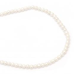 Наниз мъниста естествена перла 4~5 мм дупка 0.5 мм клас АА цвят крем ~75 броя