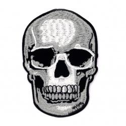 Aplicarea adezivului craniu 70x100 mm