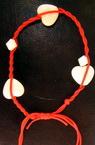 Гривна червена с пластмасови елементи -50 броя