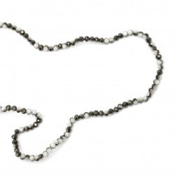 Наниз мъниста кристал 4x3 мм дупка 1 мм галванизиран наполовина бяло и черно ~150 броя
