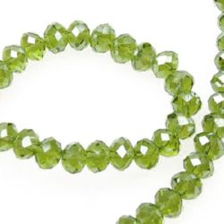 Наниз мъниста кристал 6x4 мм дупка 1 мм ДЪГА прозрачен зелен светло ~100 броя