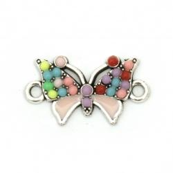 Свързващ елемент метал пеперуда цветна 21x12x3 мм дупка 2 мм цвят сребро -2 броя