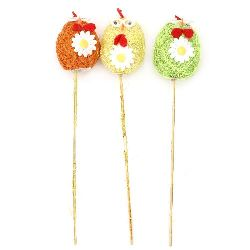Chicken egg with coconut grass 63x40 mm on a stick 250 mm MIX